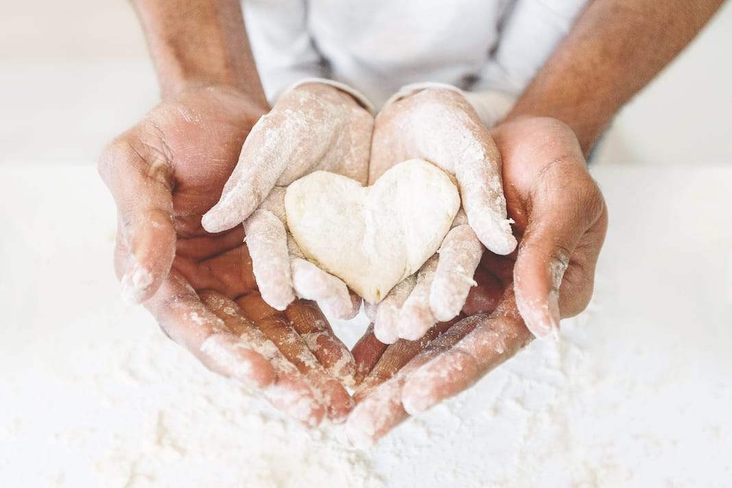 Afro, Man's, Hands, Holding, Childs, Hands, With, Heart, Shaped, Pastry